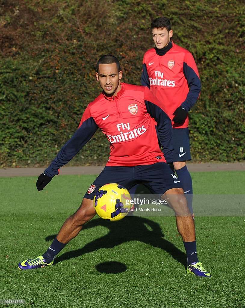 Theo Walcott and Mesut Ozil of Arsenal during a training session at London Colney on November 22, 2013 in St Albans, England.