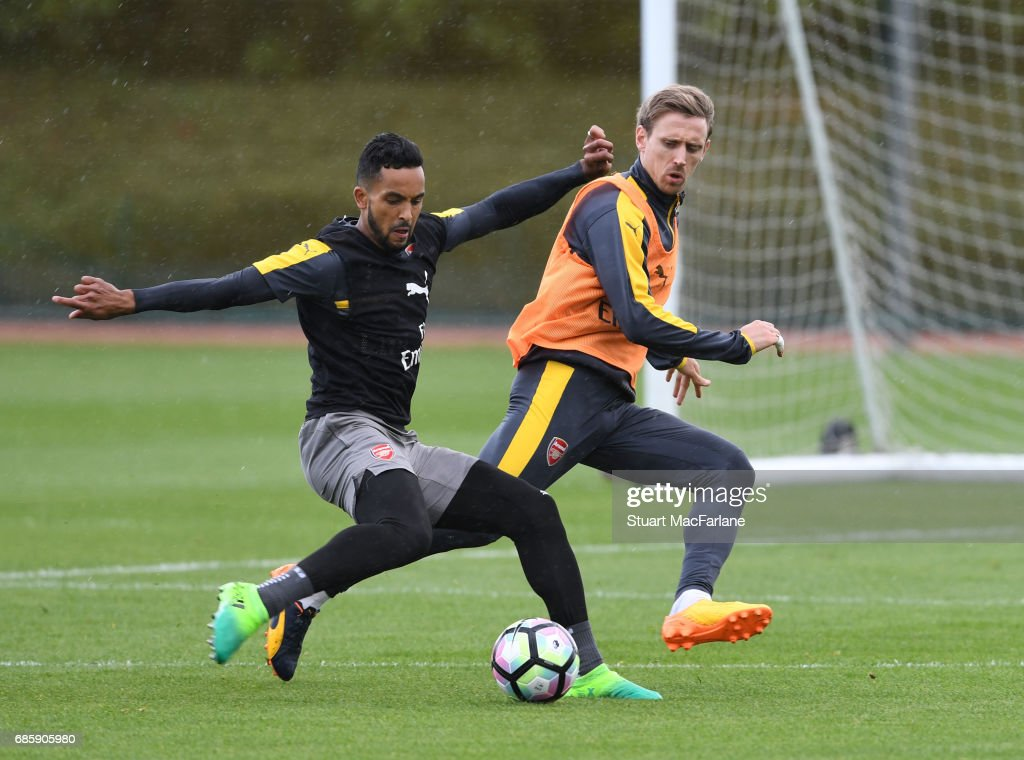 Theo Walcott and Nacho Monreal of Arsenal during a training session at London Colney on May 20, 2017 in St Albans, England.