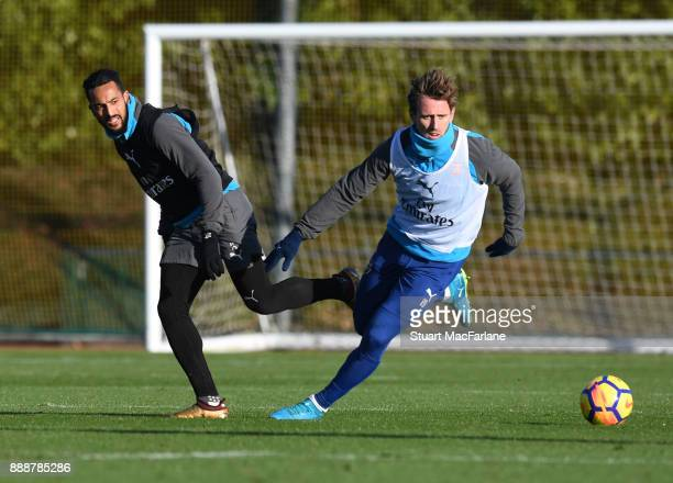 Theo Walcott and Nacho Monreal of Arsenal during a training session at London Colney on December 9 2017 in St Albans England