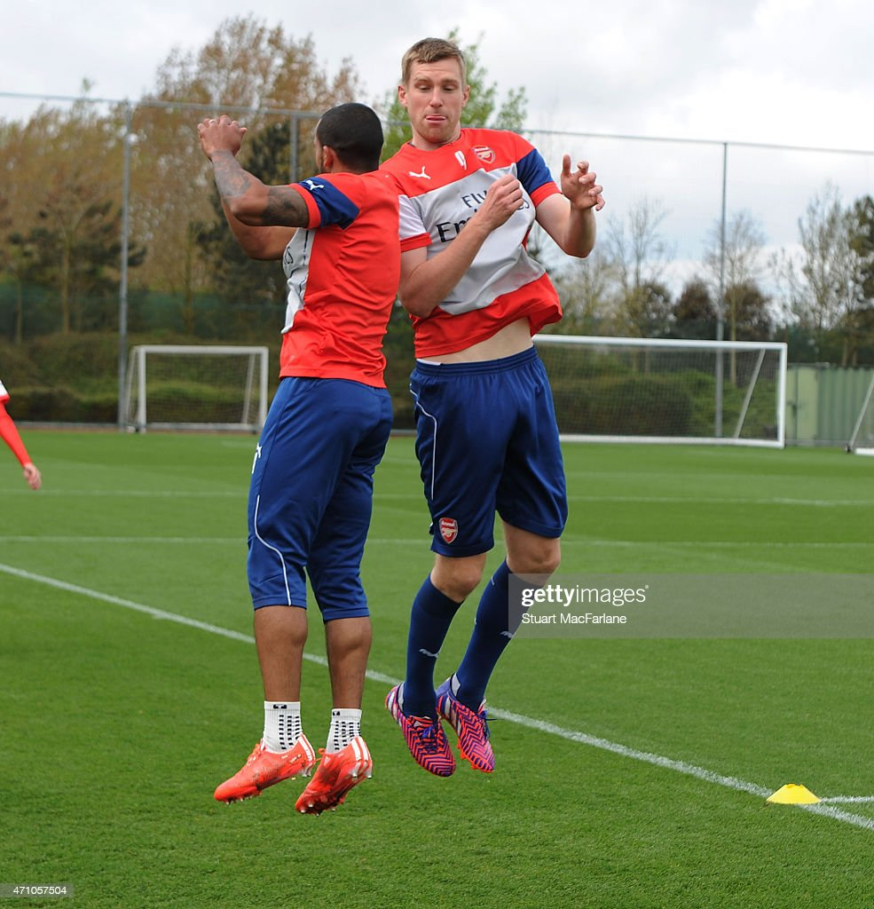 Theo Walcott and Per Mertesacker of Arsenal during a training session at London Colney on April 25, 2015 in St Albans, England.