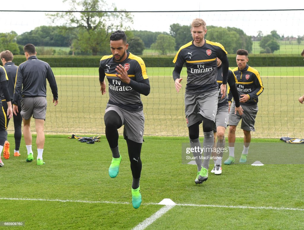 Theo Walcott and Per Mertesacker of Arsenal during a training session at London Colney on May 20, 2017 in St Albans, England.