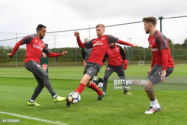 Theo Walcott and Per Mertesacker of Arsenal during Arsenal 1st team training session at London Colney on September 16 2017 in St Albans England