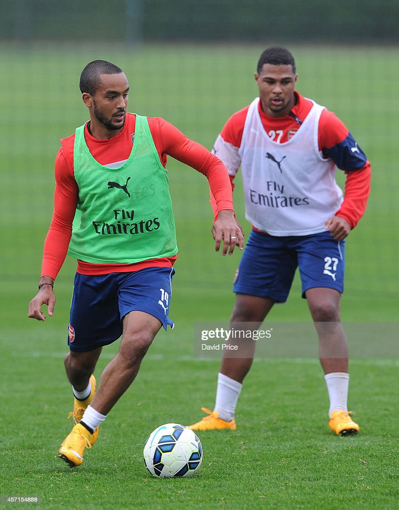 Theo Walcott and Serge Ganbry of Arsenal during the Arsenal 1st team training session at London Colney on October 13, 2014 in St Albans, England.