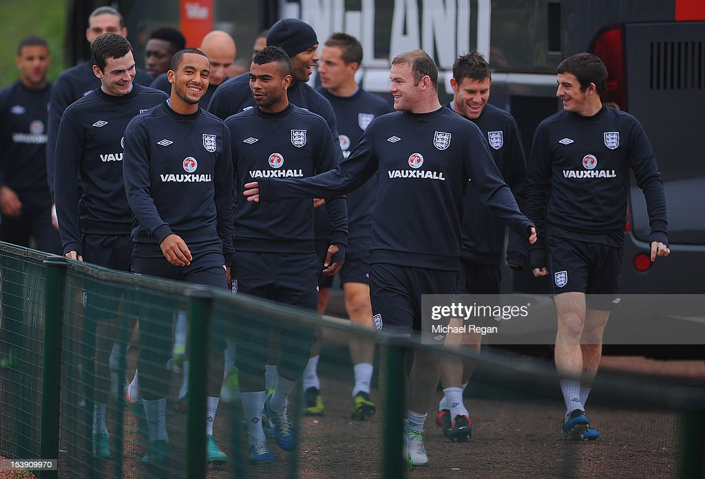 Theo Walcott, Ashley Cole and Wayne Rooney lead the squad out during the England training session ahead of their FIFA World Cup qualifier against San Marino at London Colney on October 11, 2012 in St Albans, England.