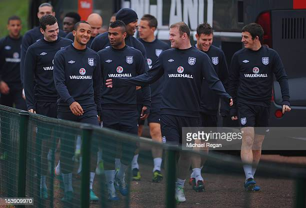 Theo Walcott Ashley Cole and Wayne Rooney lead the squad out during the England training session ahead of their FIFA World Cup qualifier against San...