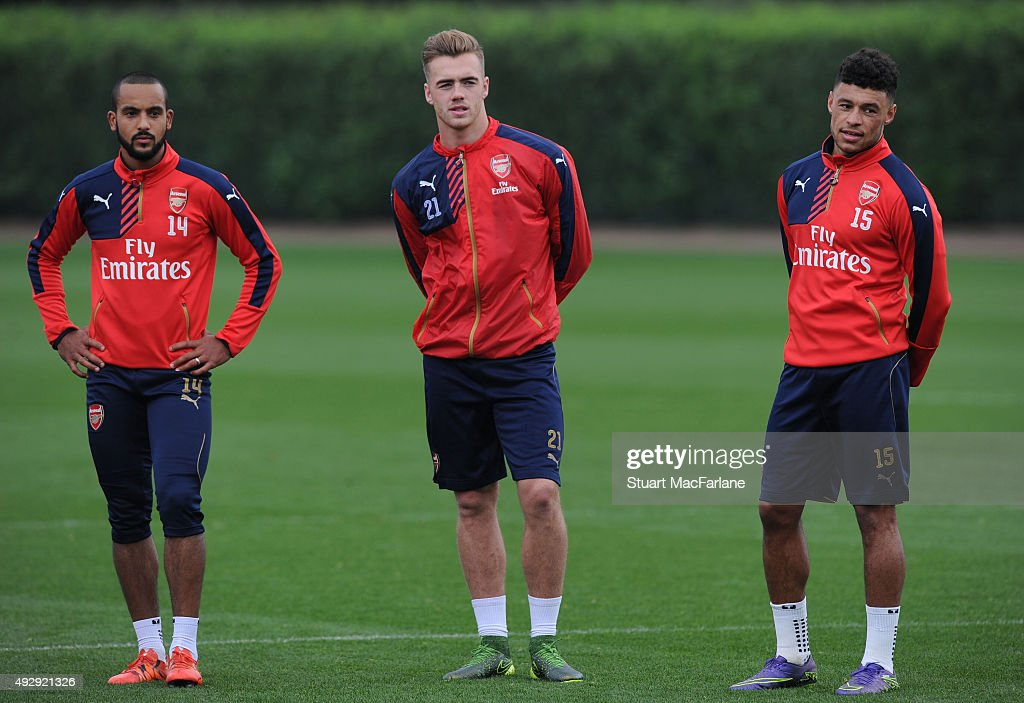Theo Walcott, Calum Chambers and Alex Oxlade-Chamberlain of Arsenal during a training session at London Colney on October 16, 2015 in St Albans, England.