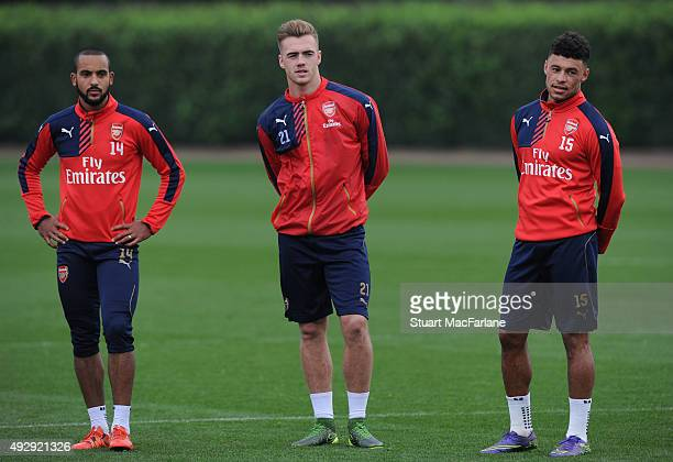 Theo Walcott Calum Chambers and Alex OxladeChamberlain of Arsenal during a training session at London Colney on October 16 2015 in St Albans England