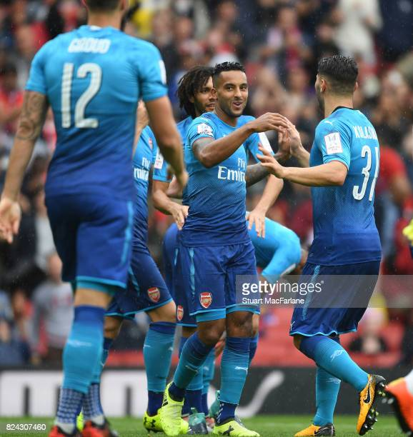 Theo Walcott ceelbrates the 3rd Arsenal goal with Sead Kolasinac during the Emirates Cup match between Arsenal and SL Benfica at Emirates Stadium on...