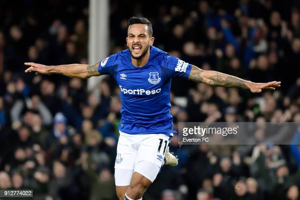 Theo Walcott celebrates his first goal during the Premier League match between Everton and Leicester City at Goodison Park on January 31 2018 in...