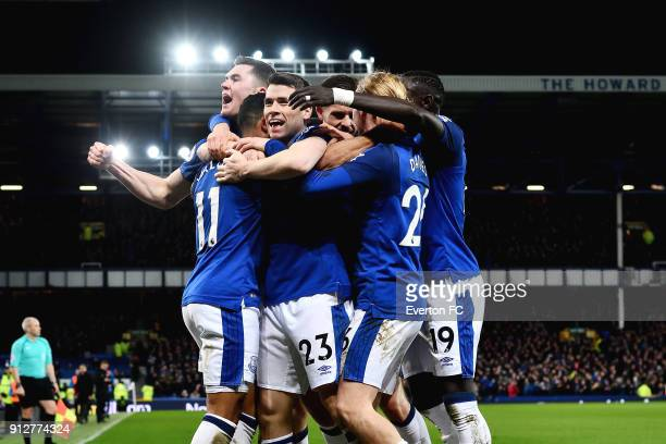 Theo Walcott celebrates his first goal with Seamus Coleman and Michael Keane during the Premier League match between Everton and Leicester City at...