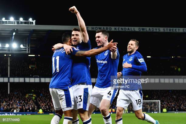 Theo Walcott celebrates his first goal with Seamus Coleman Michael Keane and Gylfi Sigurdsson during the Premier League match between Everton and...