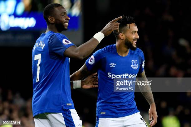 Theo Walcott celebrates his goal with Yannick Bolasie during the Premier League match between Everton and Newcastle United at Goodison Park on April...