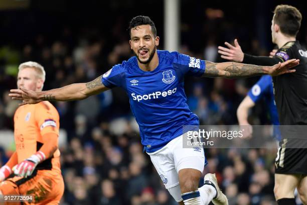 Theo Walcott celebrates his second goal during the Premier League match between Everton and Leicester City at Goodison Park on January 31, 2018 in...
