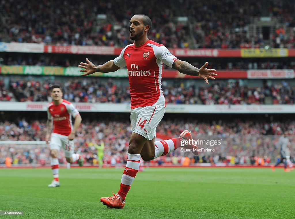 Theo Walcott celebrates scoring for Arsenal during the Barclays Premier League match between Arsenal and West Bromwich Albion at Emirates Stadium on May 24, 2015 in London, England.