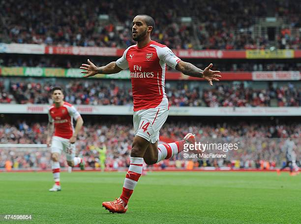 Theo Walcott celebrates scoring for Arsenal during the Barclays Premier League match between Arsenal and West Bromwich Albion at Emirates Stadium on...