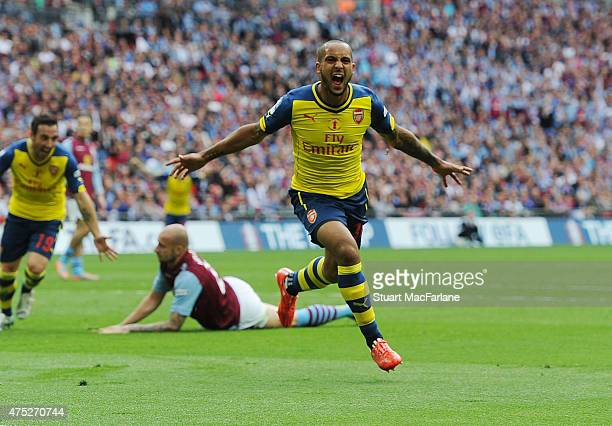Theo Walcott celebrates scoring for Arsenal during the FA Cup Final between Aston Villa and Arsenal at Wembley Stadium on May 30 2015 in London...