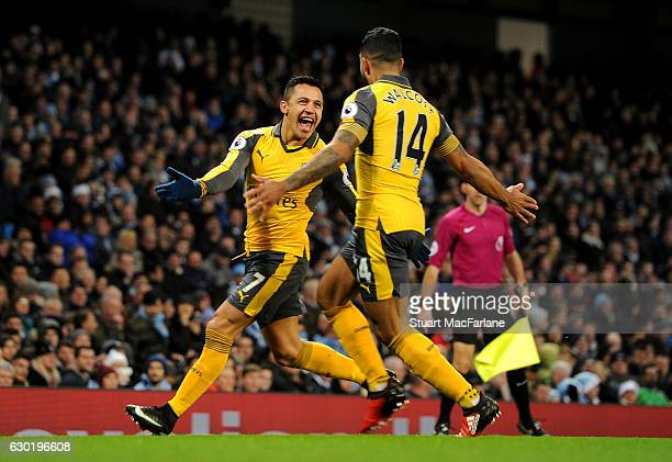 Theo Walcott celebrates scoring for Arsenal with Alexis Sanchez during the Premier League match between Manchester City and Arsenal at Etihad Stadium...