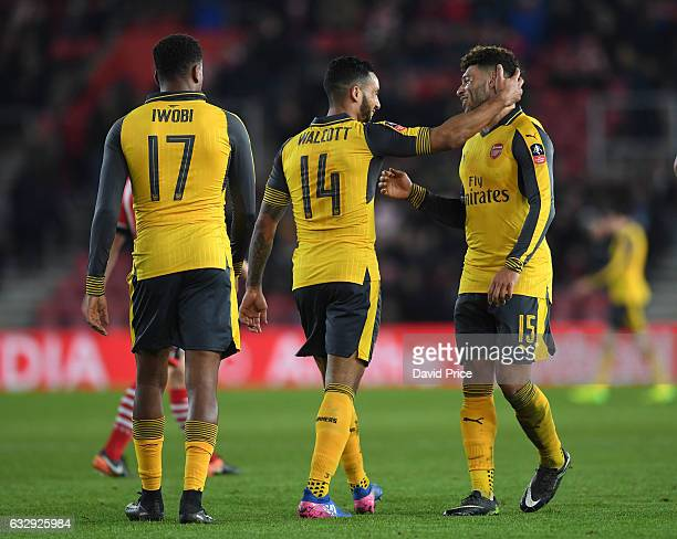 Theo Walcott celebrates scoring his 2nd goal Arsenal's 4th with Alex OxladeChamberlain during the match between Southampton and Arsenal at St Mary's...