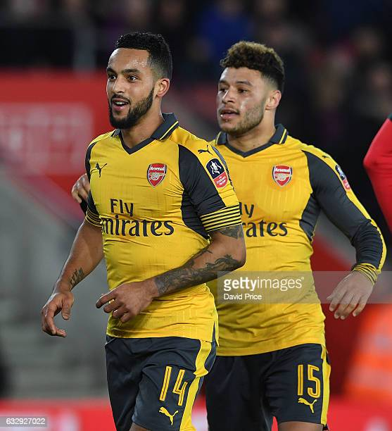 Theo Walcott celebrates scoring his 3rd goal Arsenal's 5th with Alex OxladeChamberlain during the match between Southampton and Arsenal at St Mary's...