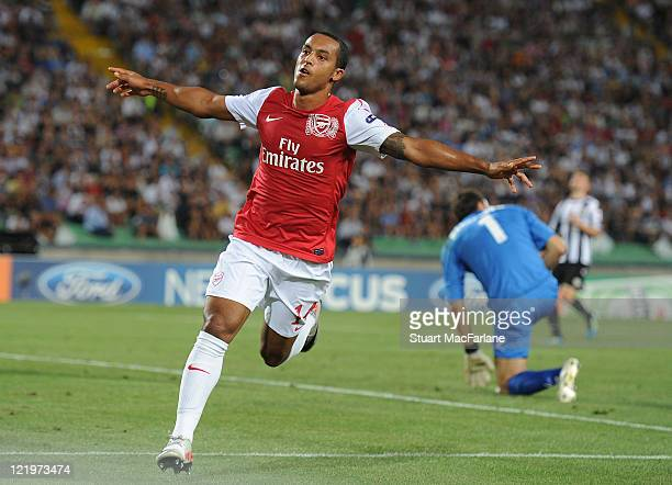 Theo Walcott celebrates scoring his team's second goal during the UEFA Champions League play-off second leg match between Udinese Calcio and Arsenal...