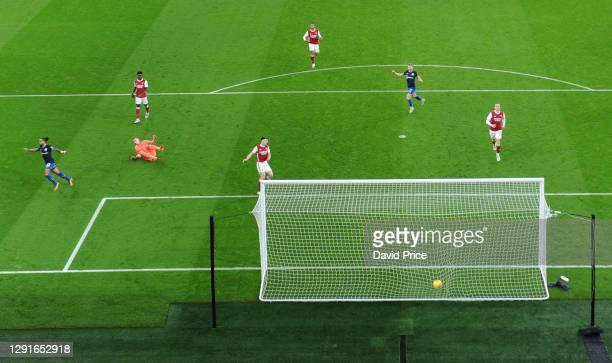 Theo Walcott celebrates scoring Southampton's goal during the Premier League match between Arsenal and Southampton at Emirates Stadium on December...