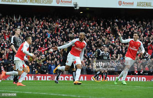 Theo Walcott celebrates scoring the 1st Arsenal goal with Alexis Sanchez and Mesut Ozil during the Barclays Premier League match between Arsenal and...