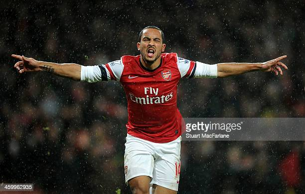 Theo Walcott celebrates scoring the 2nd Arsenal goal during the match at Emirates Stadium on January 1 2014 in London England
