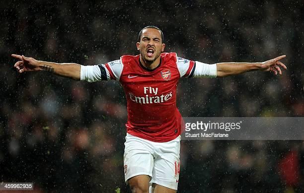 Theo Walcott celebrates scoring the 2nd Arsenal goal during the match at Emirates Stadium on January 1 2014 in London England