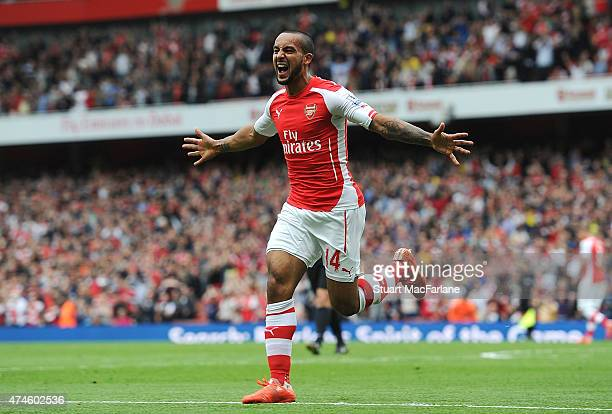 Theo Walcott celebrates scoring the 2nd Arsenal goal during the Barclays Premier League match between Arsenal and West Bromwich Albion at Emirates...