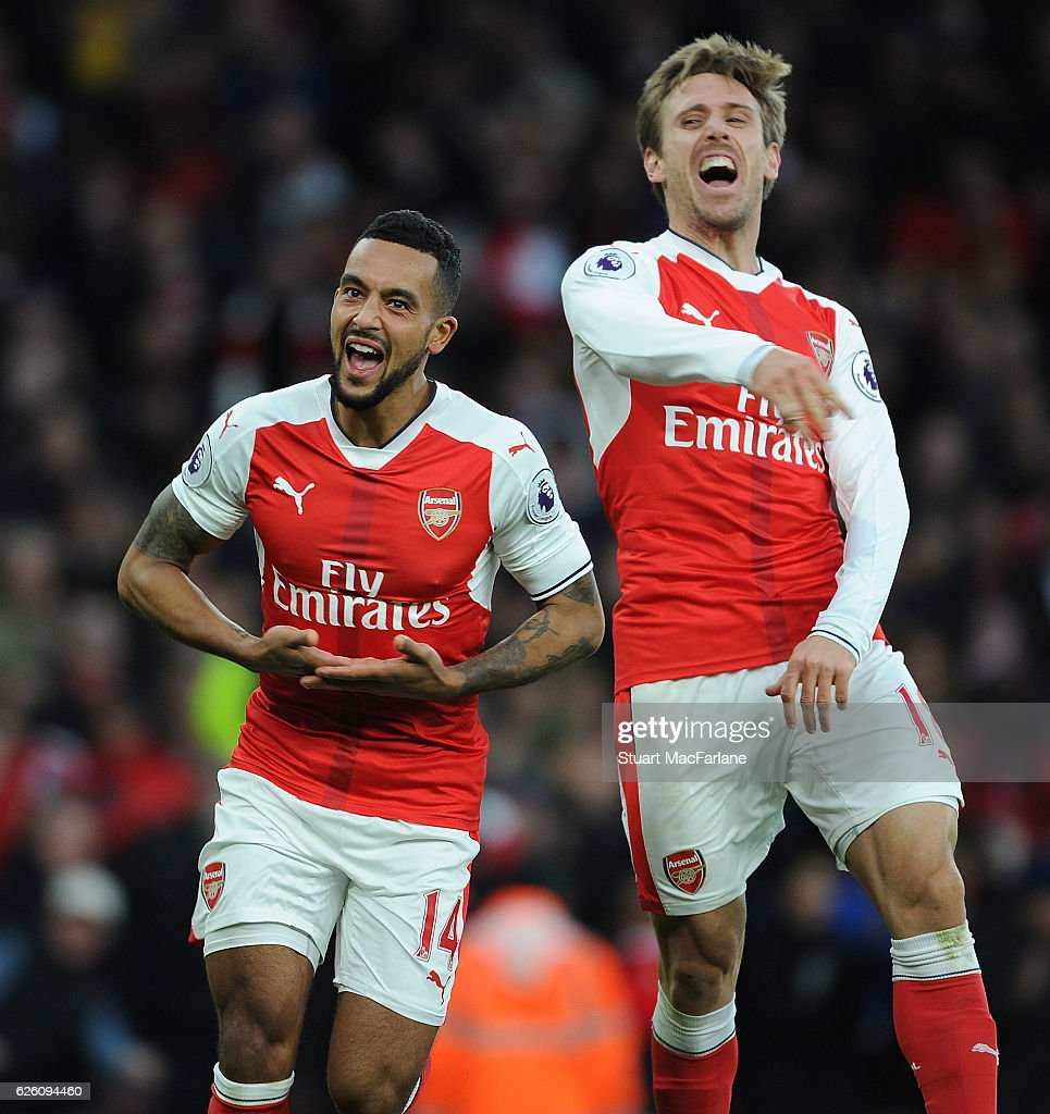 Theo Walcott celebrates scoring the 2nd Arsenal goal with (R) Nacho Monreal during the Premier League match between Arsenal and AFC Bournemouth at Emirates Stadium on November 27, 2016 in London, England.