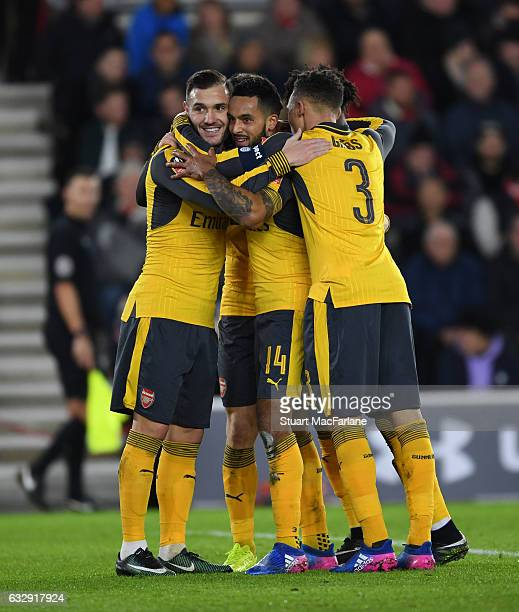 Theo Walcott celebrates scoring the 3rd Arsenal goal with Lucas Perez and Kieran Gibbs during the Emirates FA Cup Fourth Round match between...