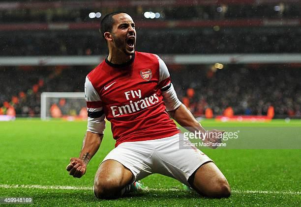 Theo Walcott celebrates scoring the second Arsenal goal during the match at Emirates Stadium on January 1 2014 in London England
