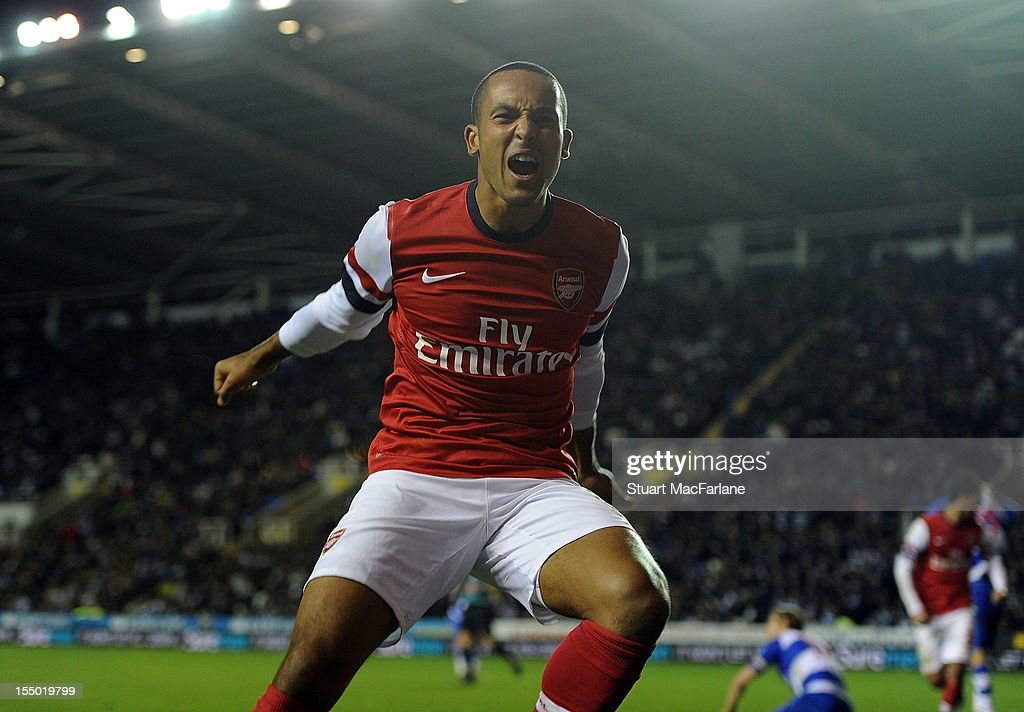 Theo Walcott celebrates scoring the sixth Arsenal goal with Olivier Giroud during the Capital One Cup match between Arsenal and Reading at Madejski Stadium on October 30, 2012 in Reading, England.