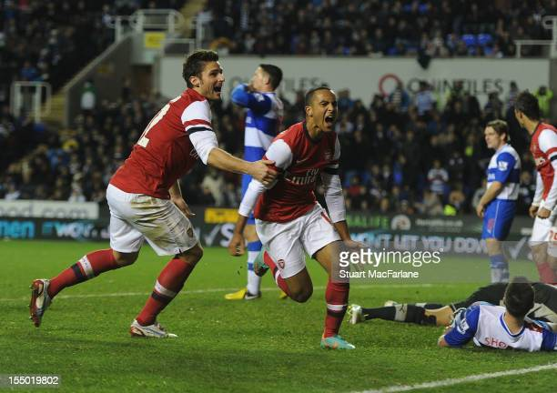 Theo Walcott celebrates scoring the sixth Arsenal goal with Olivier Giroud during the Capital One Cup match between Arsenal and Reading at Madejski...
