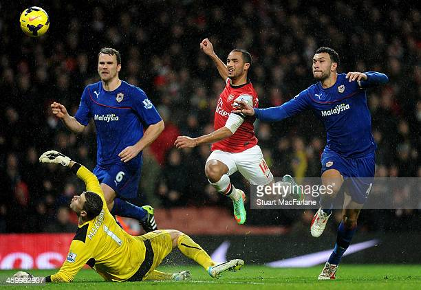 Theo Walcott chips the ball over Cardiff goalkeeper David Marshall to score the 2nd Arsenal goal at Emirates Stadium on January 1 2014 in London...