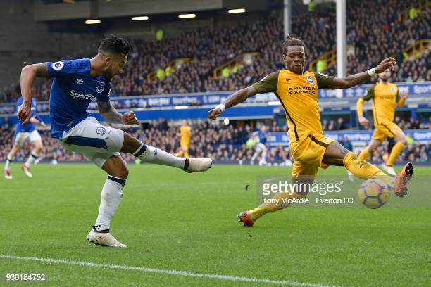 Theo Walcott crosses the ball during the Premier League match between Everton and Brighton and Hove Albion at Goodison Park on March 10 2018 in...