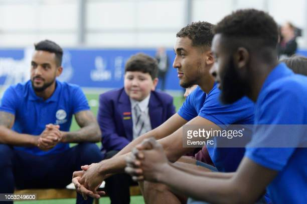 Theo Walcott Dominic CalvertLewin and Beni Baningime takes part part in the Everton in the Community event at USM Finch Farm on October 24 2018 in...