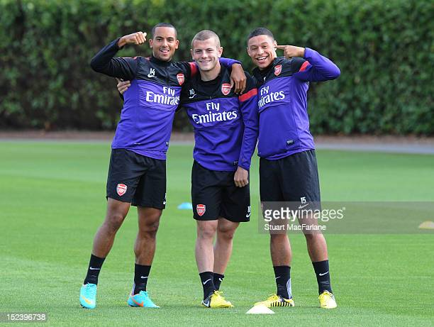 Theo Walcott, Jack Wilshere and Alex Oxlade-Chamberlain of Arsenal pose during a first team training session at London Colney on September 20, 2012...