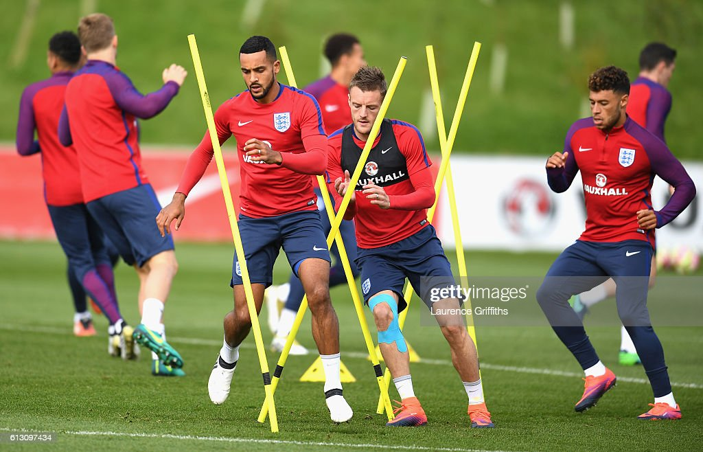 Theo Walcott, Jamie Vardy and Alex Oxlade-Chamberlain of England warm up during an England training session ahead of the FIFA 2018 World Cup Group F Qualifier match against Malta at St Georges Park on October 7, 2016 in Burton-upon-Trent, England.