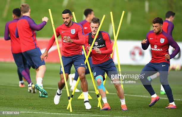 Theo Walcott Jamie Vardy and Alex OxladeChamberlain of England warm up during an England training session ahead of the FIFA 2018 World Cup Group F...