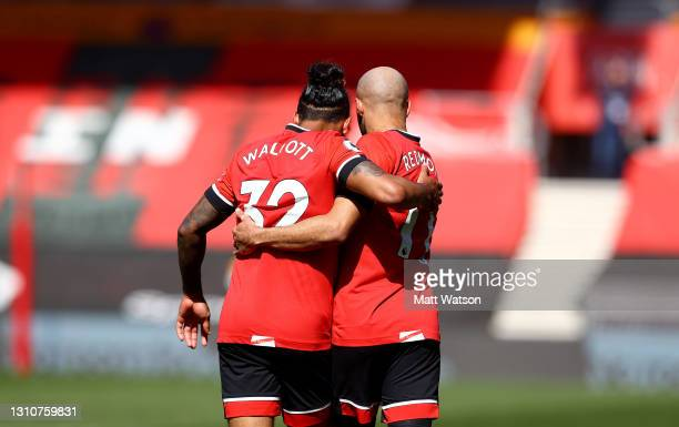 Theo Walcott of and Nathan Redmond react during the Premier League match between Southampton and Burnley at St Mary's Stadium on April 04, 2021 in...