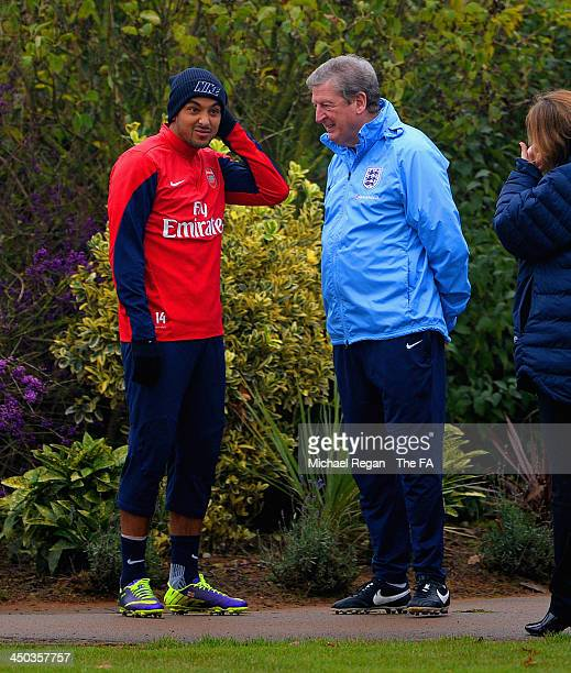 Theo Walcott of Arsenal and England manager Roy Hodgson look on during the England training session at London Colney on November 18, 2013 in St...