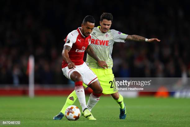 Theo Walcott of Arsenal and Leonardo Bittencourt of FC Koeln in action during the UEFA Europa League group H match between Arsenal FC and 1 FC Koeln...