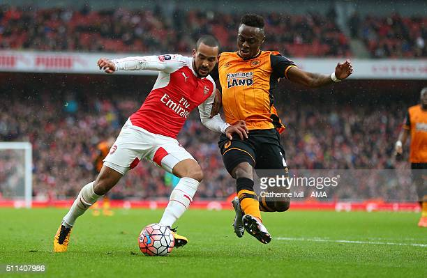 Theo Walcott of Arsenal and Moses Odubajo of Hull City during the Emirates FA Cup match between Arsenal and Hull City at the Emirates Stadium on...