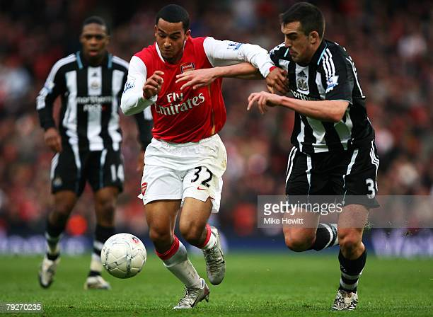 Theo Walcott of Arsenal and Sanchez Jose Enrique of Newcastle United battle for the ball during the FA Cup Sponsored by e.on Fourth Round match...