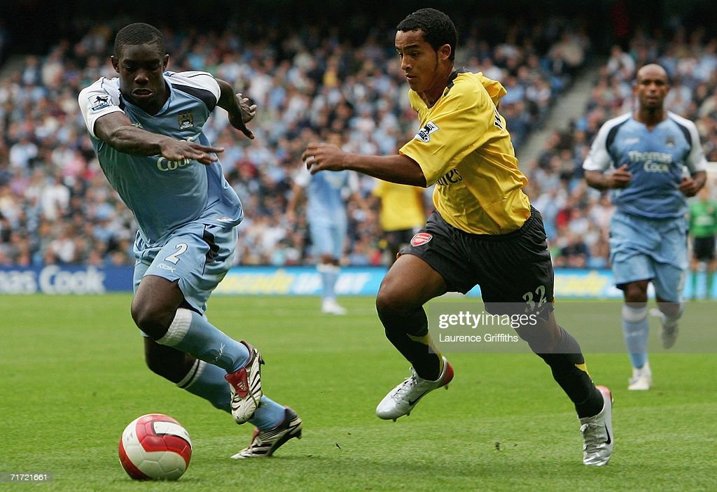 Theo Walcott of Arsenal battles for the ball with Micah Richards of Manchester City during the Barclays Premiership match between Manchester City and Arsenal at The City of Manchester Stadium on August 26, 2006 in Manchester, England.