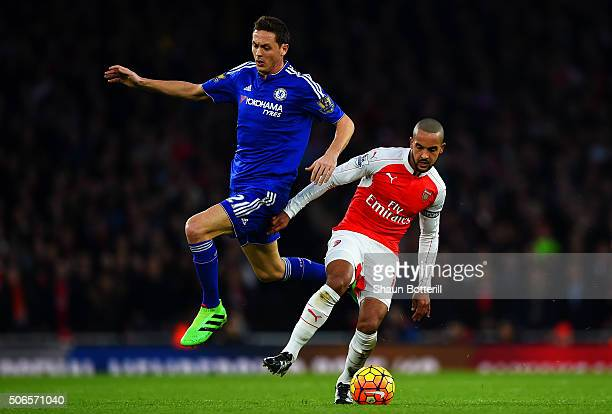 Theo Walcott of Arsenal battles for the ball with Nemanja Matic of Chelsea during the Barclays Premier League match between Arsenal and Chelsea at...
