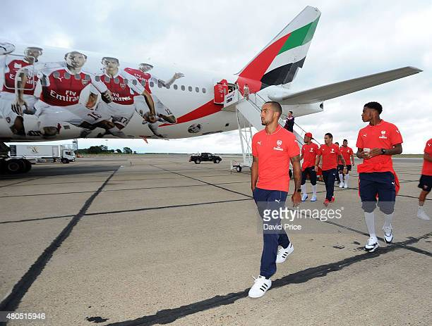 Theo Walcott of Arsenal before boarding the Emirates plane at Stansted Airport on July 12 2015 in London England