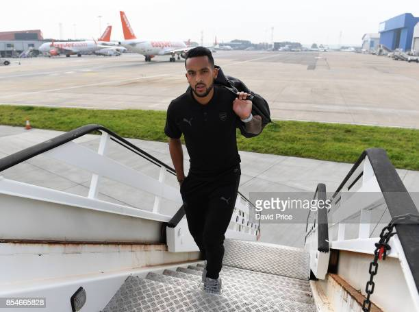 Theo Walcott of Arsenal boards the plane at Luton Airport on September 27 2017 in Luton England