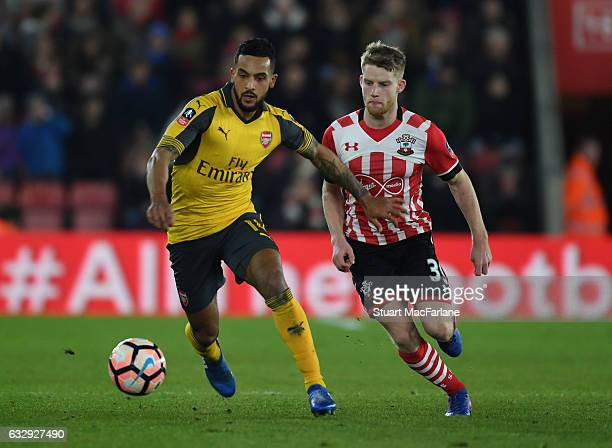 Theo Walcott of Arsenal breaks past Josh Sims of Southampton during the Emirates FA Cup Fourth Round match between Southampton and Arsenal at St...